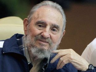 Fidel Castro makes a surprise appearance at the 6th Communist Party Congress in Havana, Cuba, Tuesday April 19, 2011. Cuba's President Raul Castro was named first secretary of Cuba's Communist Party on Tuesday, with Fidel not included in the leadership for the first time since the party's creation 46 years ago. (AP Photo/Javier Galeano)
