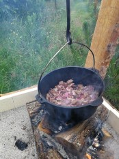Cooking onion and beef for goulash