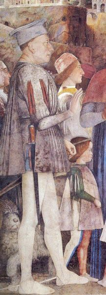 He is wearing white painted greaves and probably has a cuirasse under his giornea. c. 1470