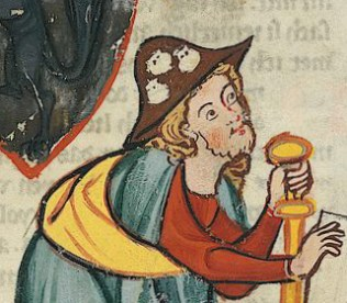 The man is dressed as a pilgrim on the Way of St James with the requisite staff, scrip or shoulder-bag, and cockle shells on his hat. First half of 1300's