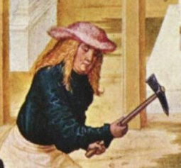 Bavarian stonemasons wear knee-length tunics, hose, and ankle-high shoes. He is also wearing a pink wide brimed hat, c. 1505.