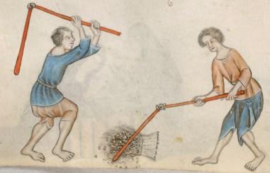 Two men wearing loose shirts and braies while threshing grain