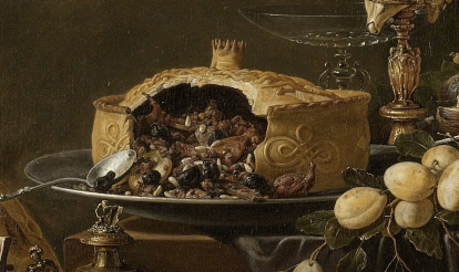 A postej filled with what looks like prunes, small game, almonds, raisins and more