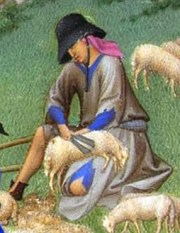 Peasant in in a tattered tunic over a blue tunic with sheep, 1416