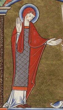 Saint wearing what looks to be a cyclas over a chemise. She is also wearing a red mantle drapped over her head. ca. 1170s