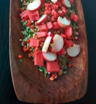 This version was clean up the fridge salad. It had an oil based vigenette, peaches, water melon, parsley, bell peppers and radishes.