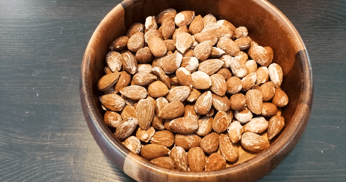 A bowl of salted almonds