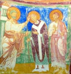 Painting of Saint Peter consecrating Hermagoras, wearing purple, as a bishop. Circa 1180 freco in Basilica di Santa Maria Assunta