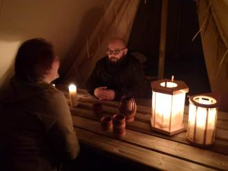 A cosy evening in the dark tent light by candle light