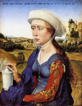 Lady in a blue dress. From the look of it the dress is sleeveless. She wears pinned loose sleeves in a beautiful brocade fabric. Under the dress she wears a white shift that peaks out at the edge of the sleeve and over collar of the blue dress.
