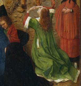 Early example of the style: Loose green overdress with sleeve that hit the elbow. All the edges of the dress are edge in white fur. It looks to maybe be a open robe rather than a dress. Under the green robe, she is wearing a red dress and a white shift is peeking out underneath.