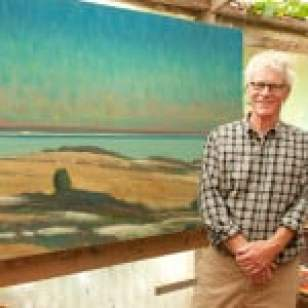 Painter Allen Whiting in his studio with his work,