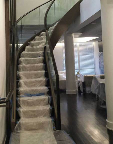 stairs wrapped in plastic in home undergoing renovation