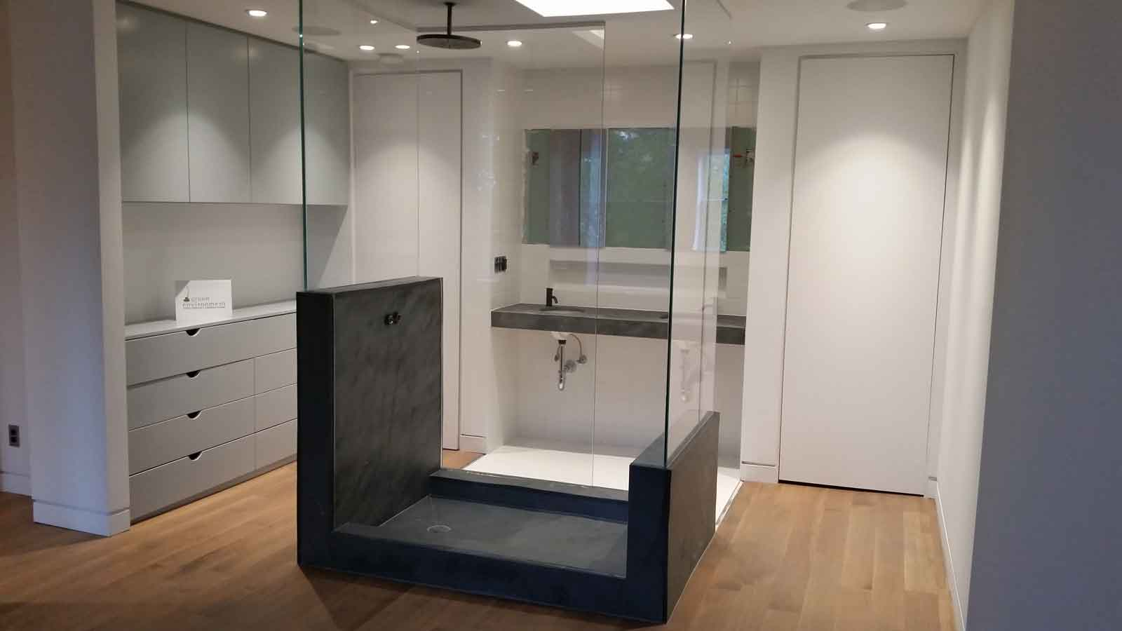 Luxury bathroom with glass-walled central shower.