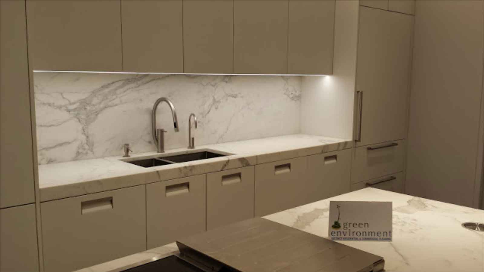 Kitchen with marble backsplash and counter.
