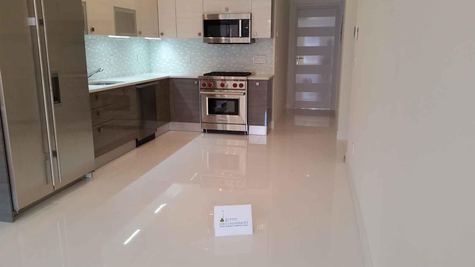 Recently remodeled kitchen with tile backsplash and custom cabinets.