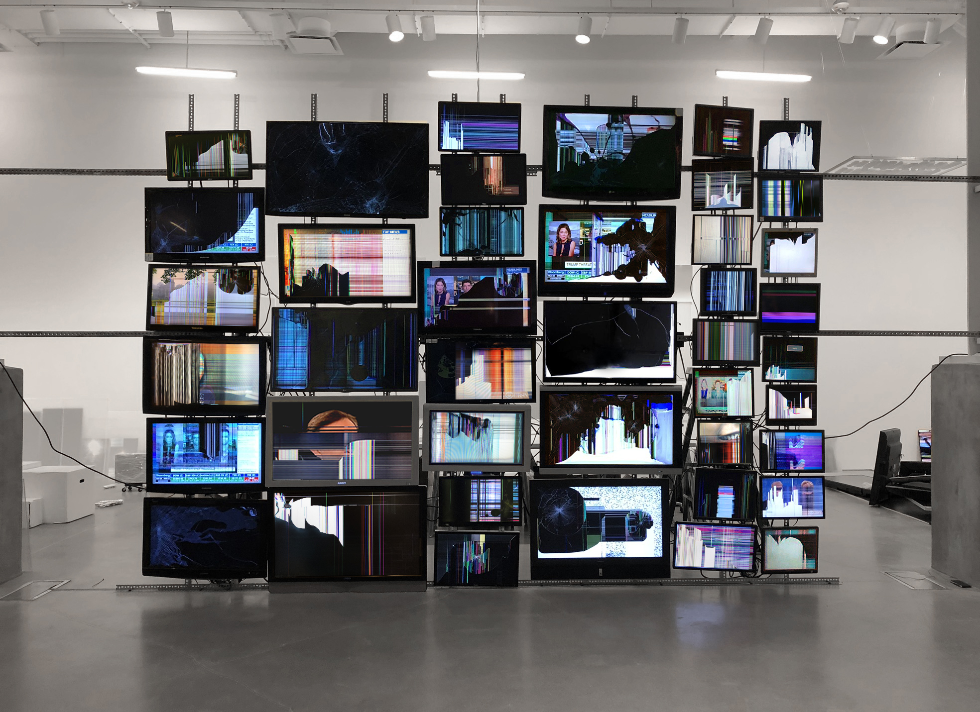Rows of glitching tv screens stacked on top of each other.