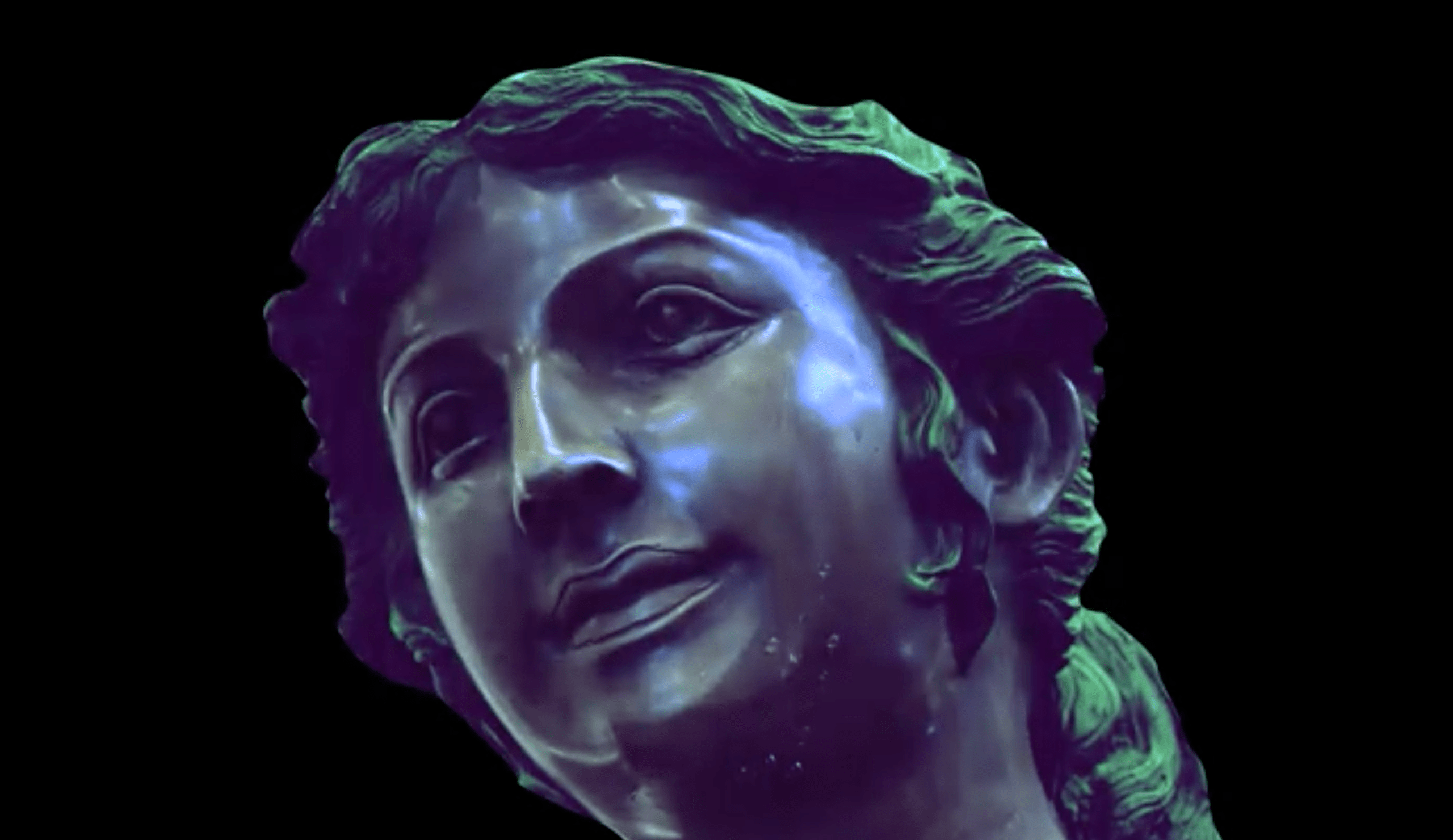 close up of classical sculptures as tears stream slowly down their faces.