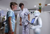 A-young-boy-talks-with-the-robot-Pepper