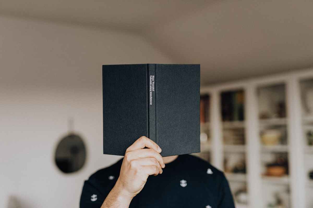 anonymous man with book in hand