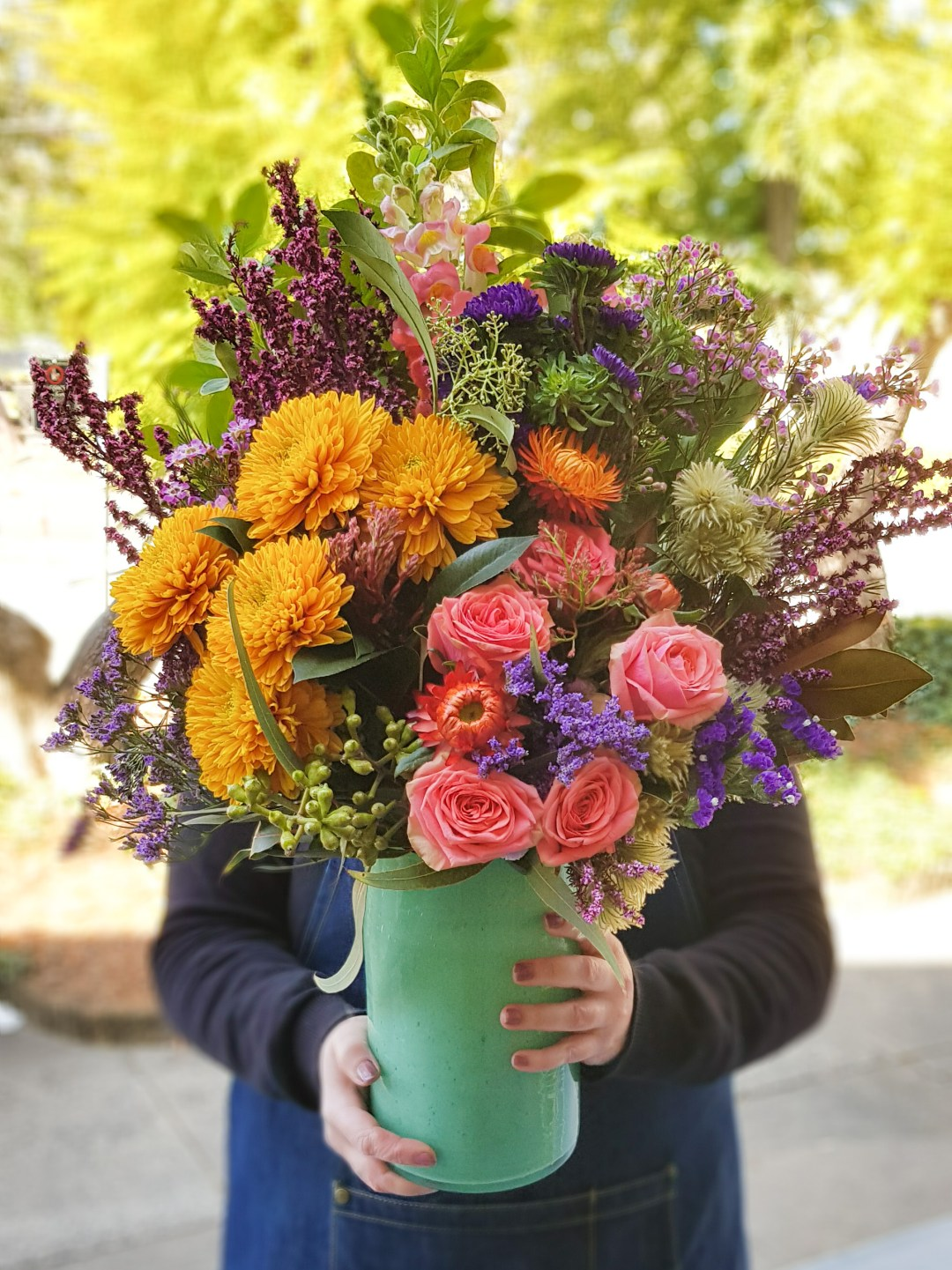 Lush and colourful fresh flower bouquet in a green vase from Posy & Twin Florist in Telopea, NSW