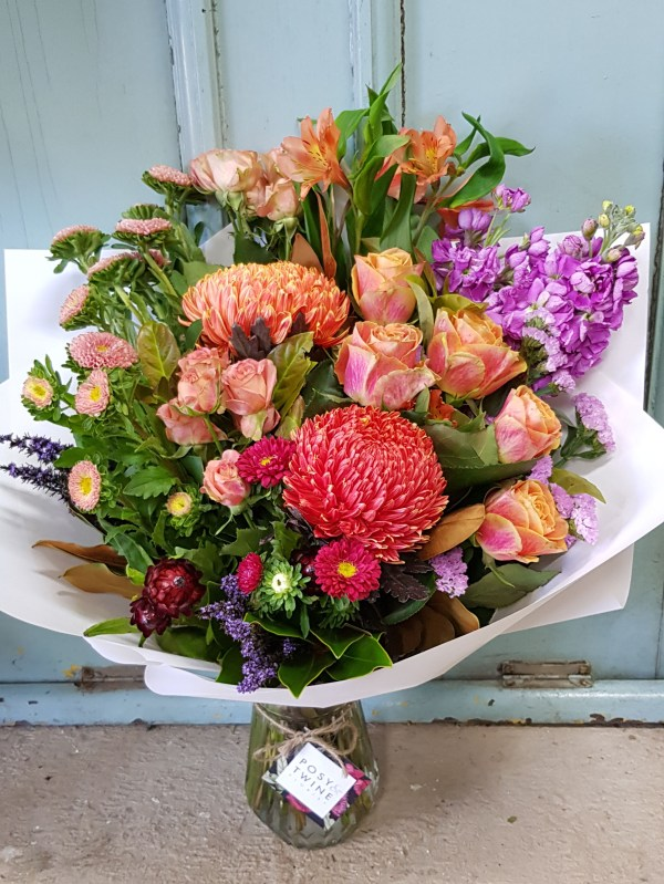 Bright bouquet in small vase Posy & Twine