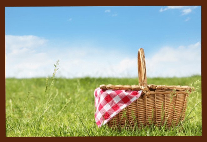 Picnic basket in a field on a summers day