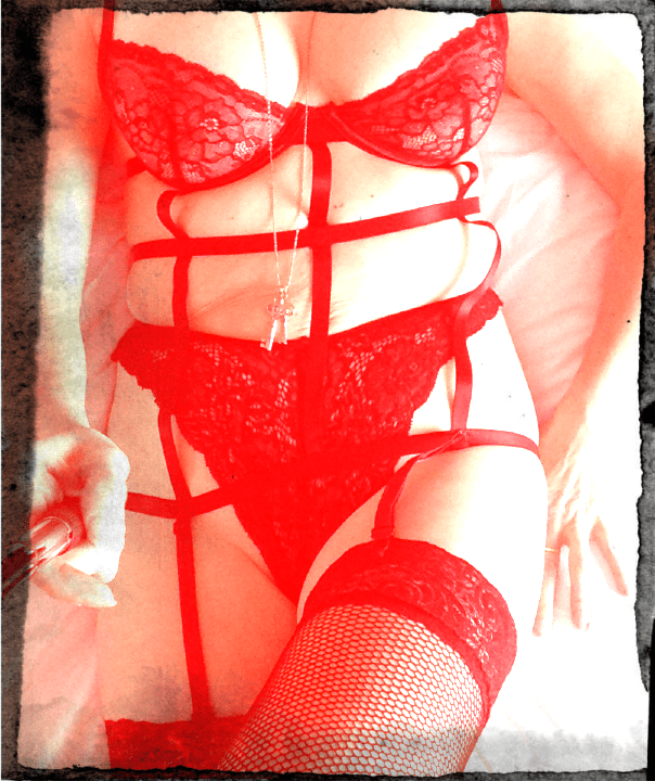 Red cage construction underwear and fishnet stockings