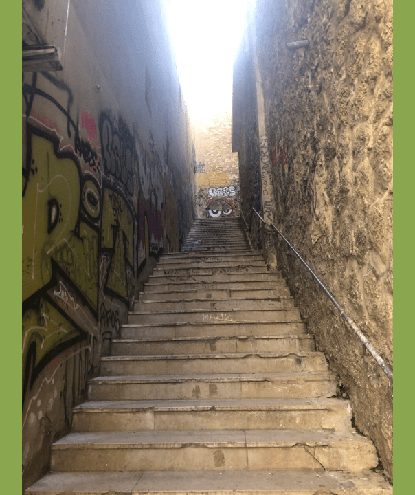 Stone staircase with graffitti