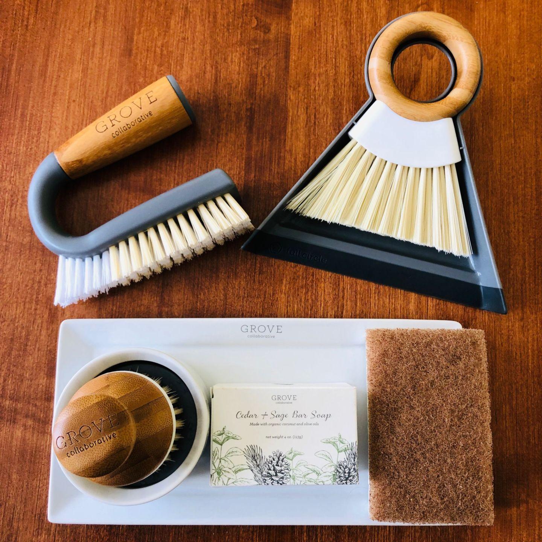 grout brush, mini broom & dust pan, bubble up brush, soap, walnut scrubber sponge on tray