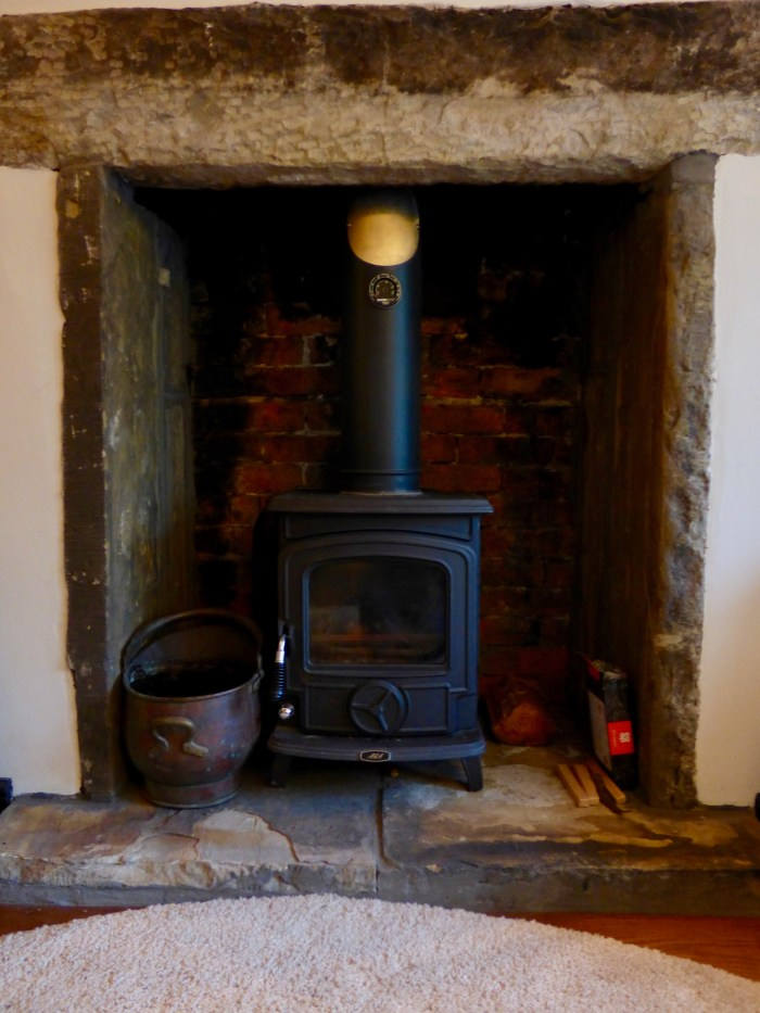 Woodburner in the lounge at Pots and Pans Holiday Cottage, Uppermill, Saddleworth