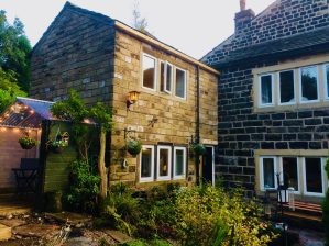 The outside of Pots and Pans Holiday Cottage, Uppermill, Saddleworth