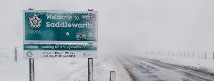 A road sign covered in snow on the A635 on Saddleworth Moor in the historic county of York. (Photo by Anthony Devlin/PA Images via Getty Images)
