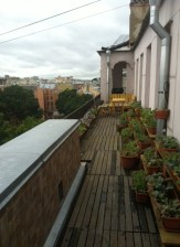 The exterior balcony/breakfast nook that runs the length of the roofline
