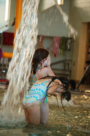 Chic and friend under dumbing water bucket