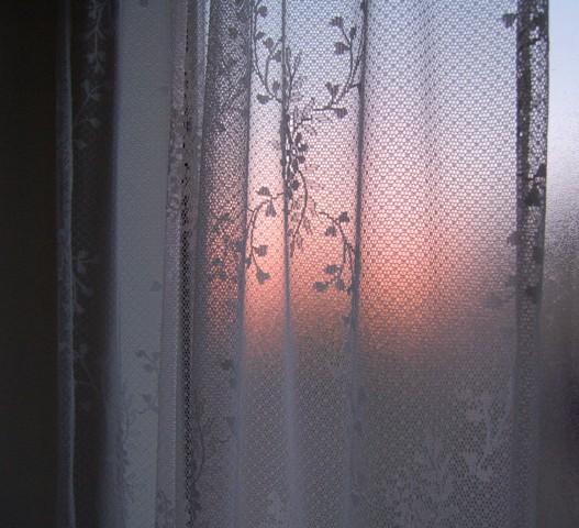 "Sunset through lace curtain over ""garden tub"""