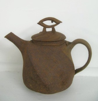 altered teapot w/ unglazed exterior