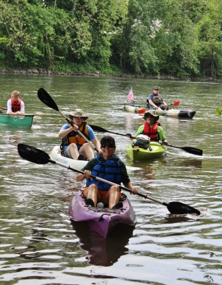 People paddle in kayaks at Riverfront Park in Pottstown as part of the 18th annual Schuylkill River Sojourn. Paddling is one of many outdoor activities that are can be done in the summer.