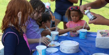 Children decorate sugar cookies during a Back to School Community Blockbuster Saturday at the Ricketts Center in Pottstown.