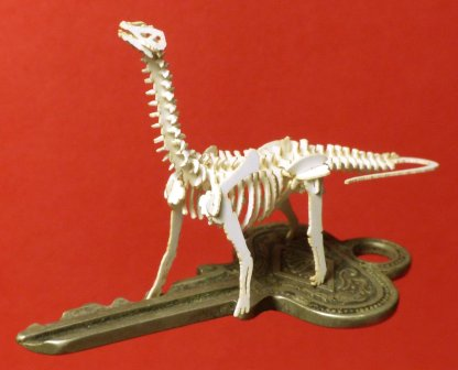 Brontosaurus tiny skeleton model by Tinysaur on a house key for scale. They really are tiny!