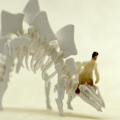 Tiny hand-painted person riding a stegosaurus Tinysaur skeleton