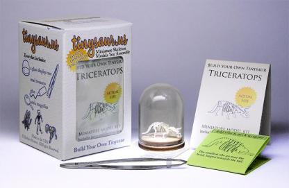 Triceratops all-in-one miniature skeleton model kit with laser-cut bones, glass display dome, instructions, tweezers, glue, a magnifier, and packaging by Tinysaur.us