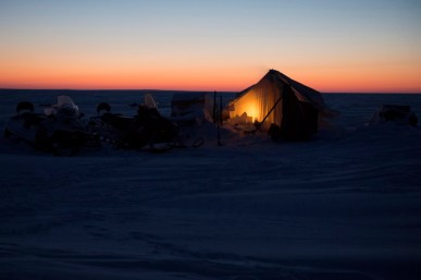 1 Canadian Ranger Patrol Group (1CRPG) Ranger Hernnery Lyall and Bruce Takolik both from Taloyoak, NU settle in for the night at the wreck site of Her Majesty's Ship (HMS) Erebus from the Sir Franklin expedition on April 12, 2015 during Operation NUNALIVUT. Photo: Master Seaman Peter Reed, Formation Imaging Services, Halifax
