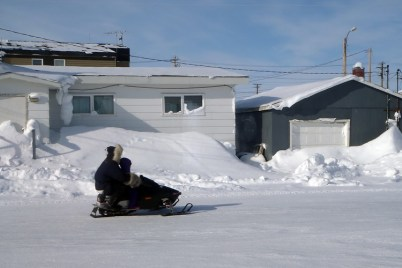 Mini snowmobile called a 120 for a kid but here being ridden by father and small son
