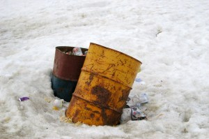 Cambridge Bay garbage/rubbish bins emerging from the snow