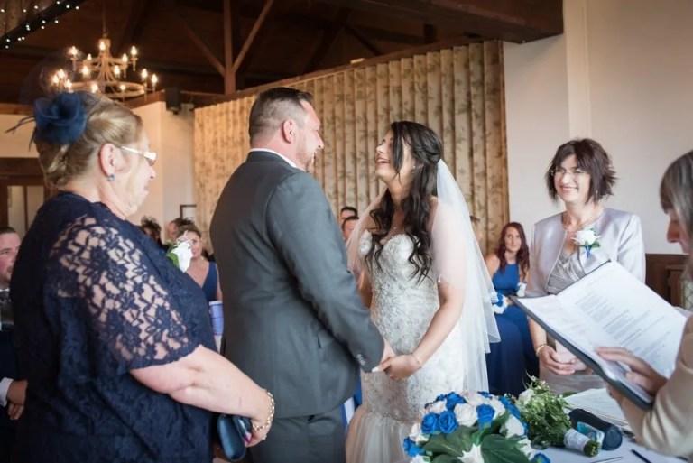 Bride and groom exchange rings at Cumberwell Park wedding venue