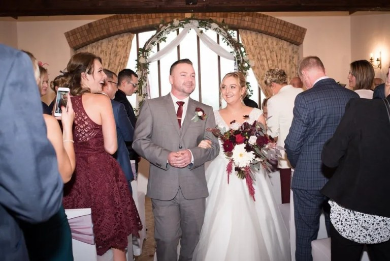 Bride and groom first kiss at Cumberwell Park wedding venue