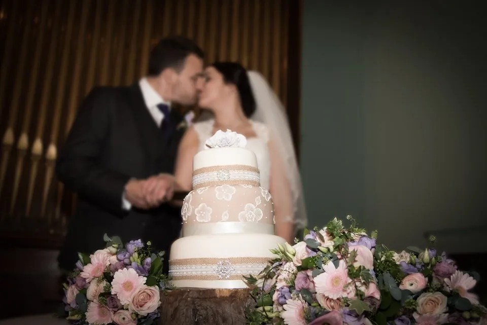 Bride and Groom cutting the wedding cake on Their Wedding Day at Leigh Court in Bristol