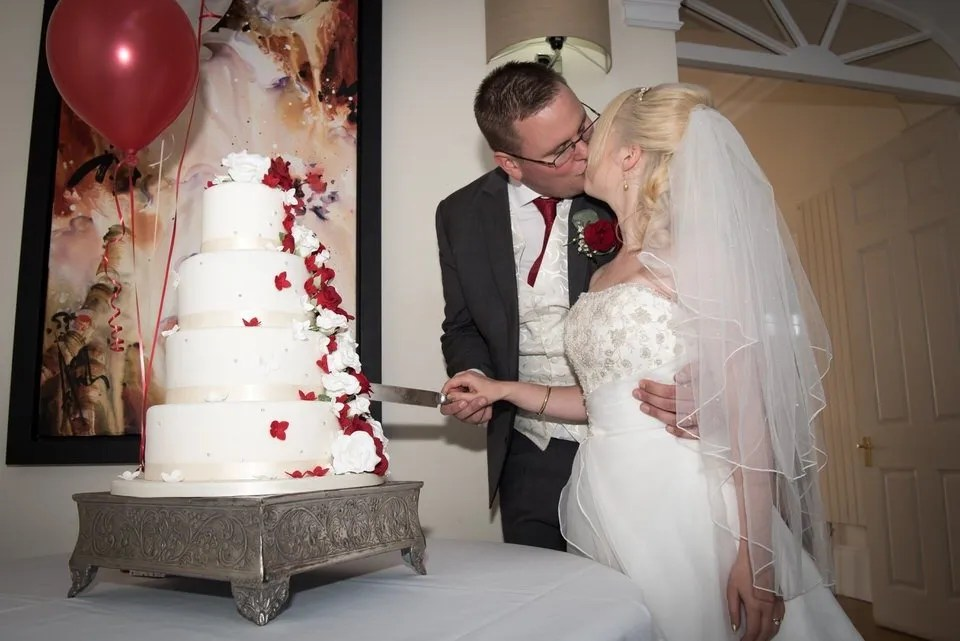 Cutting the wedding cake at Old Down Manor in Bristol