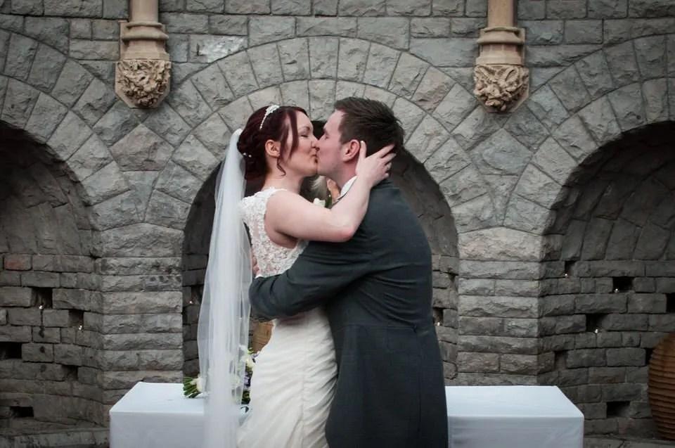 First kiss at Tortworth Court wedding in Bristol